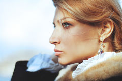 Close-up portrait of woman from last century at autumn day Royalty Free Stock Photos