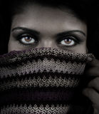 Close up portrait of woman with mystery eyes. Closeup portrait of woman with mystery eyes Royalty Free Stock Image