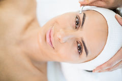 Close-up portrait of woman receiving facial massage Royalty Free Stock Image