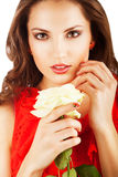 Close-up portrait of woman in red dress with white rose Royalty Free Stock Photos