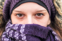 Close up portrait of woman 's face wearing winter clothes Royalty Free Stock Photos