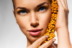 Close up portrait of woman with sea-buckthorn Stock Photo