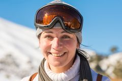 Close up portrait of a woman at a snow ski center. Stock Images