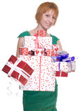 Close up portrait of woman with some gifts. Close up portrait of emotional woman in green dress with some gifts box royalty free stock photos