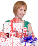 Close up portrait of woman with some gifts. Close up portrait of emotional woman in green dress with some gifts box Stock Photography