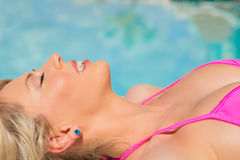 Close-up portrait of woman sunbathing by the pool Royalty Free Stock Photography