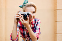 Close up portrait of a woman taking photos using camera Stock Photography