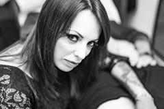 Close up portrait woman tattoo artist working tattoo Royalty Free Stock Image