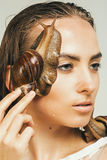 Close up portrait of woman with two snails Royalty Free Stock Photography