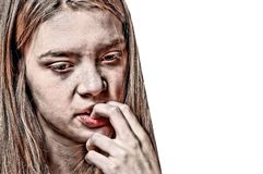 Close Up Portrait of a Worried Girl Biting her Nails royalty free stock images