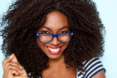 Close up young african american woman with curly hair wearing glasses. Close up portrait of young african american woman with curly hair wearing glasses royalty free stock images