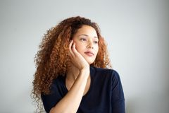 Close up young african american woman thinking and looking away Stock Image