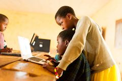 Bafoussam, Cameroon - 06 august 2018: beautiful image of african school children learning to use computer in classroom of african. Close up portrait of young royalty free stock photo