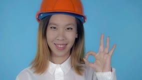Beautiful korean happy builder showing gesture good stock image