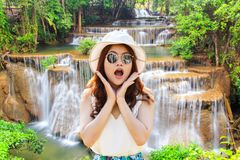 Close up portrait young asian woman beautiful girl with long red hair looking excited holding her mouth opened amazing waterfall i Stock Photography