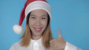 Beautiful korean girl christmas showing gesture thumb up stock images