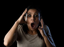 Close up portrait young attractive Latin woman screaming desperate screaming in primal fear emotion. Close up portrait young attractive Latin woman desperate and Royalty Free Stock Photos