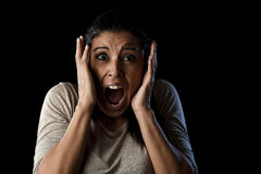 Close up portrait young attractive Latin woman screaming desperate screaming in primal fear emotion. Close up portrait young attractive Latin woman desperate and Stock Image