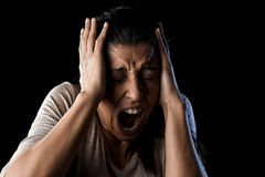 Close up portrait young attractive Latin woman screaming desperate screaming in primal fear emotion. Close up portrait young attractive Latin woman desperate and Royalty Free Stock Image