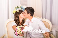 Close up portrait of young attractive romantic couple hugging and kissing. Love and relationships lifestyle, interior Stock Photos