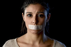 Close up portrait of young attractive woman with mouth and lips sealed in adhesive tape restrained Royalty Free Stock Photography