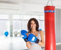 Close-up portrait of young attractive woman training on simulator in gym Royalty Free Stock Image