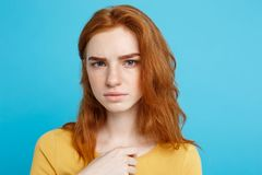 Close up Portrait young beautiful attractive redhair girl feeling nervous looking at camera. Blue Pastel Background. Copy space Stock Photography