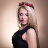 Close up portrait of young beautiful blond woman in crown over b Royalty Free Stock Photography