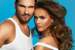 Close up portrait of young beautiful couple in love posing at studio Stock Image
