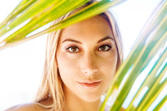 Close-up portrait of a young beautiful girl in bikini with a pal Royalty Free Stock Images