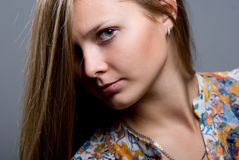 Close-up portrait of young beautiful girl in a bright colored bl royalty free stock photography