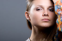 Close-up portrait of young beautiful girl in a bright colored bl royalty free stock image