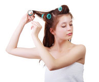 Close up portrait of Young beautiful girl having hair curlers on her head Royalty Free Stock Photography