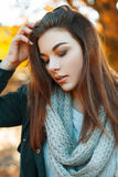 Close-up portrait of a young beautiful girl in knitted sweater, royalty free stock images