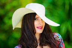 Close-up portrait young beautiful girl in a straw hat in the tro Stock Images
