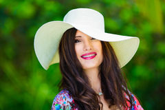 Close-up portrait young beautiful girl in a straw hat in the tro Stock Photos