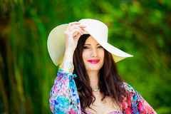 Close-up portrait young beautiful girl in a straw hat in the tro Stock Photo