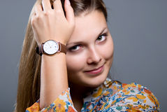 Close-up portrait of young beautiful girl with a wristwatch royalty free stock photos
