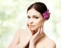 Close-up portrait of young, beautiful and healthy woman with an Stock Photography