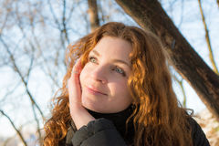 Close up portrait of a young beautiful red hair european girl looking up Royalty Free Stock Image