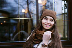 Close up portrait of young beautiful smiling woman wearing stylish clothes standing on the street. Model looking aside Stock Photos