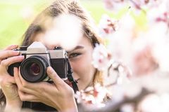 Close up portrait of woman with camera in park stock photo