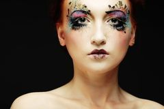Young beautiful woman with colorful bright make-up royalty free stock images