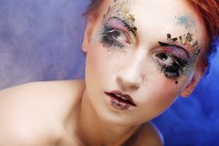 Young beautiful woman with colorful bright make-up stock image