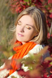 Close up portrait of young beautiful woman dreaming in autumn pa Royalty Free Stock Photos