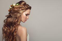 Close up portrait of young beautiful woman with flowers. royalty free stock photography