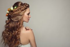 Close up portrait of young beautiful woman with flowers. Royalty Free Stock Photos