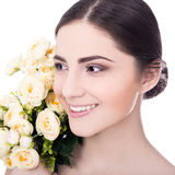 Close up portrait of young beautiful woman with flowers isolated Stock Image