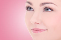 Close up portrait of young beautiful woman with long eyelashes o Stock Images
