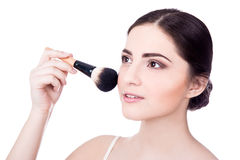Close up portrait of young beautiful woman with make up brush is. Olated on white background Stock Image